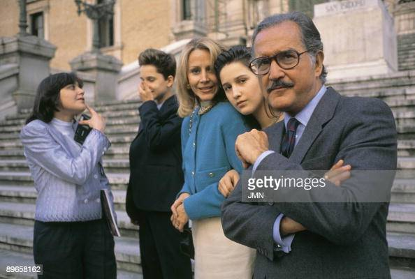 Carlos Fuentes writer next to his family in the National Library