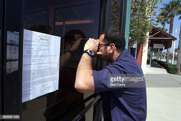Carlos Gamino looks into the window of a vacant store at the Oxnard Factory Outlet which was supposed to be the region s next large outlet center and...
