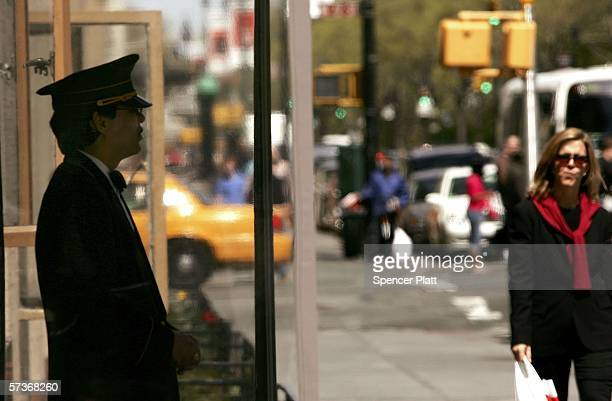 Carlos Garcia a doorman with a building on Central Park West works in front of his building April 19 2006 in New York City Thousands of New York City...