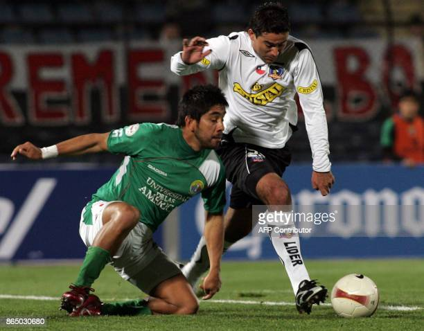 Carlos Garrido form Audax Italiano vies for the ball with Roberto Cereceda from ColoColo during their Copa Sudamericana match 04 September 2007 in...