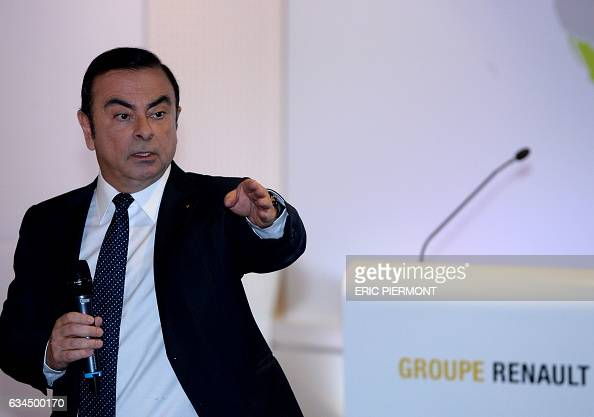 Carlos Ghosn CEO of French automaker Renault gestures as he speaks during the presentation of the group's 2016 results at the group's headquarters in...