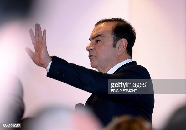 Carlos Ghosn CEO of French automaker Renault gestures during the presentation of the group's 2016 results at the group's headquarters in...