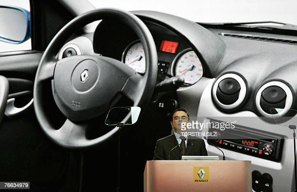 Carlos Ghosn CEO of French carmaker Renault stands in front of a projection showing a part of a Renault Sandero car as he gives a press conference to...