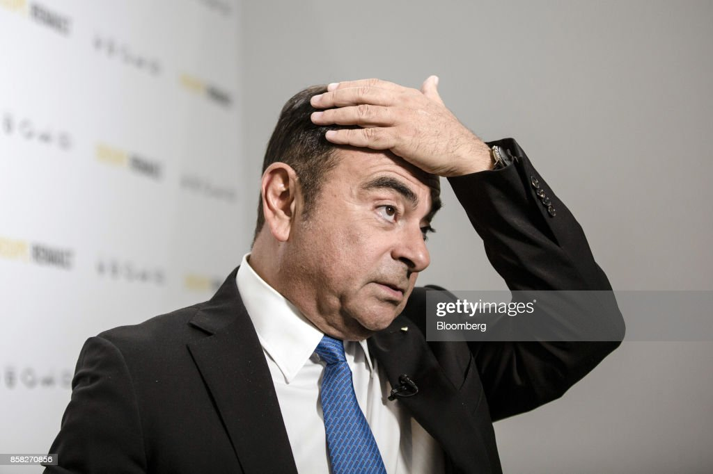 Carlos Ghosn, chairman of Renault SA, pauses ahead of a Bloomberg Television interview following a news conference to announce the automaker's strategic plan in Paris, France, on Friday, Oct. 6, 2017. Renaultraised mid-term sales and earnings targets as part of the French carmakers plan to protect its leadership inbattery-powered autos and keep pace with rivals in driverless models. Photographer: Marlene Awaad/Bloomberg via Getty Images