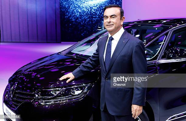 Carlos Ghosn Chief Executive Officer of Nissan Motor Co and Renault SA poses next the new Renault Espace automobile during the press day of the Paris...