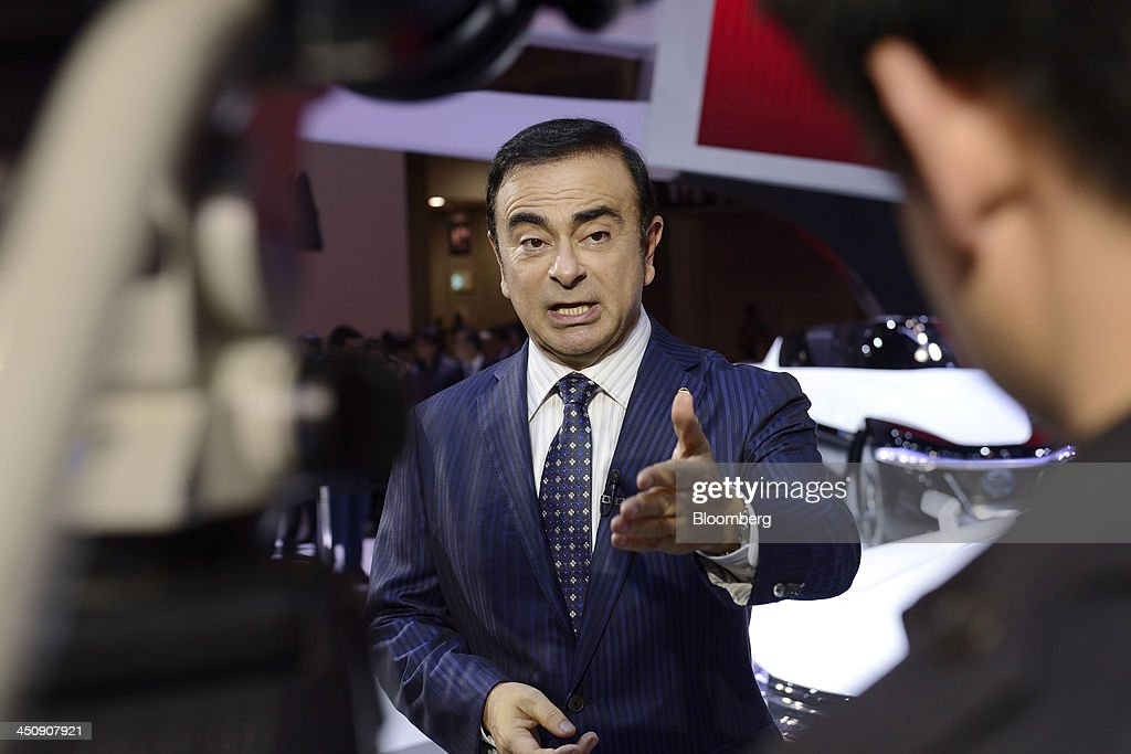 <a gi-track='captionPersonalityLinkClicked' href=/galleries/search?phrase=Carlos+Ghosn&family=editorial&specificpeople=215025 ng-click='$event.stopPropagation()'>Carlos Ghosn</a>, chief executive officer of Nissan Motor Co., gestures as he speaks during an interview at the 43rd Tokyo Motor Show 2013 in Tokyo, Japan, on Wednesday, Nov. 20, 2013. Ghosn said consumers wont take to fuel-cell vehicles before the decades end, joining Tesla Motors Inc.s Elon Musk in questioning the future of hydrogen-powered cars. Photographer: Akio Kon/Bloomberg via Getty Images