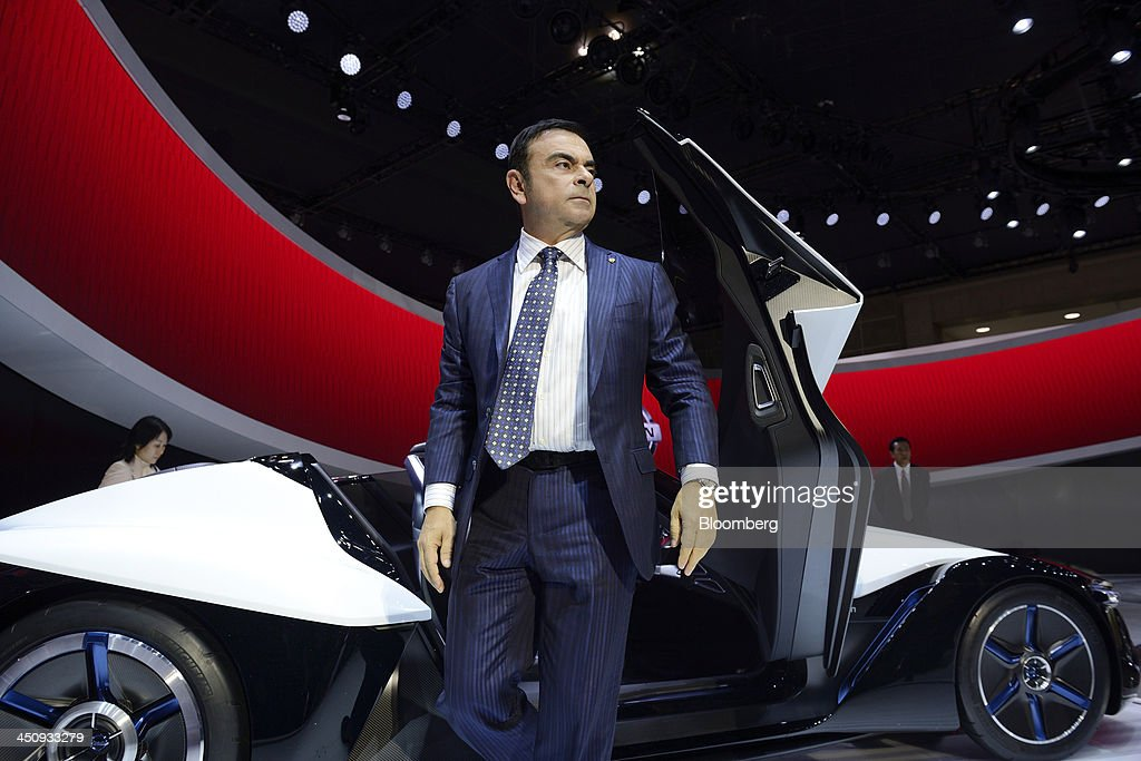 <a gi-track='captionPersonalityLinkClicked' href=/galleries/search?phrase=Carlos+Ghosn&family=editorial&specificpeople=215025 ng-click='$event.stopPropagation()'>Carlos Ghosn</a>, chief executive officer of Nissan Motor Co., gets out of the company's BladeGlider concept car following an interview at the 43rd Tokyo Motor Show 2013 in Tokyo, Japan, on Wednesday, Nov. 20, 2013. Ghosn said consumers wont take to fuel-cell vehicles before the decades end, joining Tesla Motors Inc.s Elon Musk in questioning the future of hydrogen-powered cars. Photographer: Akio Kon/Bloomberg via Getty Images