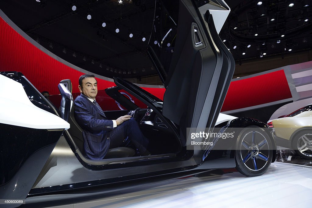 <a gi-track='captionPersonalityLinkClicked' href=/galleries/search?phrase=Carlos+Ghosn&family=editorial&specificpeople=215025 ng-click='$event.stopPropagation()'>Carlos Ghosn</a>, chief executive officer of Nissan Motor Co., poses for a photograph in the company's BladeGlider concept car following an interview at the 43rd Tokyo Motor Show 2013 in Tokyo, Japan, on Wednesday, Nov. 20, 2013. Ghosn said consumers wont take to fuel-cell vehicles before the decades end, joining Tesla Motors Inc.s Elon Musk in questioning the future of hydrogen-powered cars. Photographer: Akio Kon/Bloomberg via Getty Images