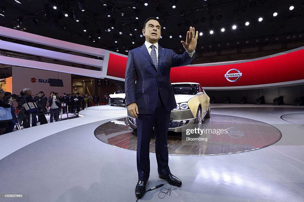 <a gi-track='captionPersonalityLinkClicked' href=/galleries/search?phrase=Carlos+Ghosn&family=editorial&specificpeople=215025 ng-click='$event.stopPropagation()'>Carlos Ghosn</a>, chief executive officer of Nissan Motor Co., speaks in front of an IDx Freeflow concept car during an interview at the 43rd Tokyo Motor Show 2013 in Tokyo, Japan, on Wednesday, Nov. 20, 2013. Ghosn said consumers wont take to fuel-cell vehicles before the decades end, joining Tesla Motors Inc.s Elon Musk in questioning the future of hydrogen-powered cars. Photographer: Akio Kon/Bloomberg via Getty Images