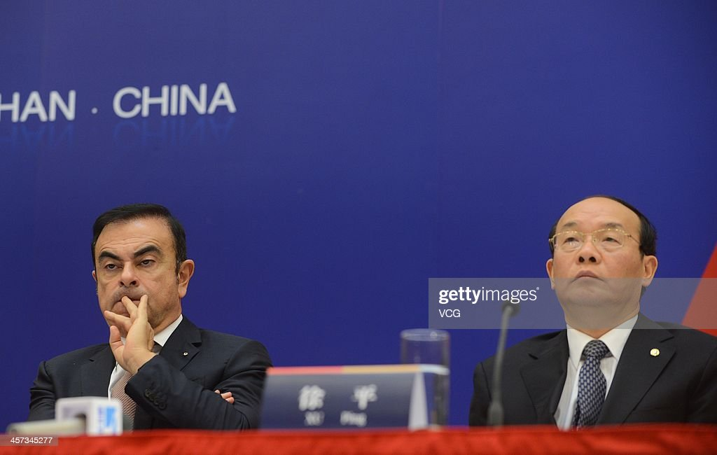 Carlos Ghosn, Chief Executive Officer of Renault, and Xu Ping (R), Chairman of Dongfeng Motor Corporation, attend a signing ceremony at Donghu Hotel on December 16, 2013 in Wuhan, China. The Dongfeng Renault Automotive Co., Ltd., a joint venture between the French automaker Renault S.A. and the Chinese automaker Dongfeng Motor Corporation, will have an initial capacity of 150,000 cars a year.