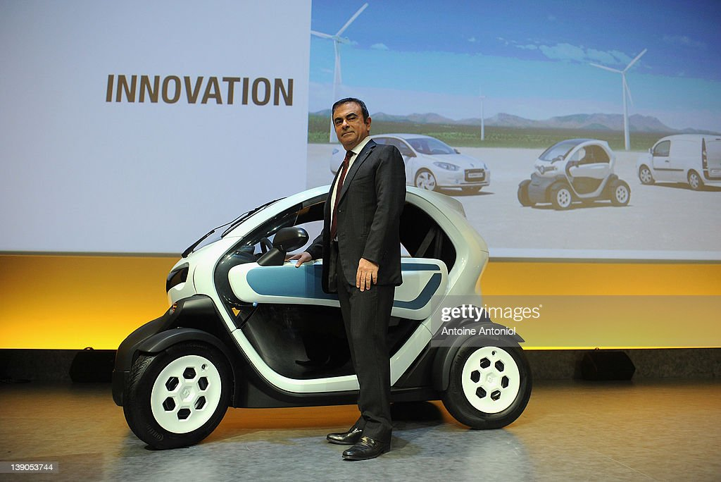 <a gi-track='captionPersonalityLinkClicked' href=/galleries/search?phrase=Carlos+Ghosn&family=editorial&specificpeople=215025 ng-click='$event.stopPropagation()'>Carlos Ghosn</a>, chief executive officer of Renault, poses next to a Renault Twizy electric car after a news conference on February 16, 2012 in Paris, France. French car manufacturer Renault reported a 9.4 percent growth.