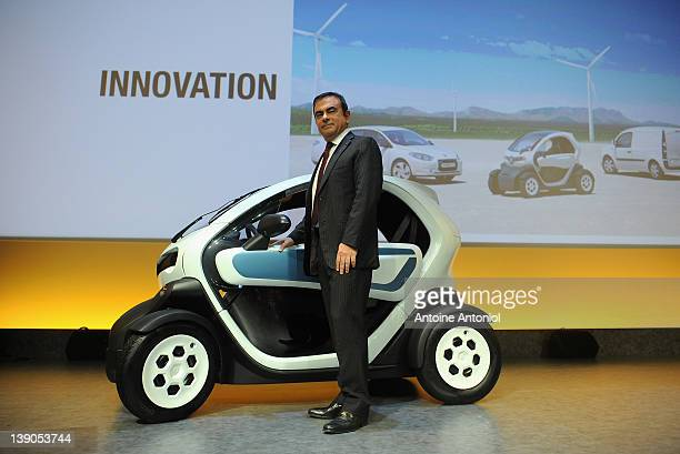 Carlos Ghosn chief executive officer of Renault poses next to a Renault Twizy electric car after a news conference on February 16 2012 in Paris...