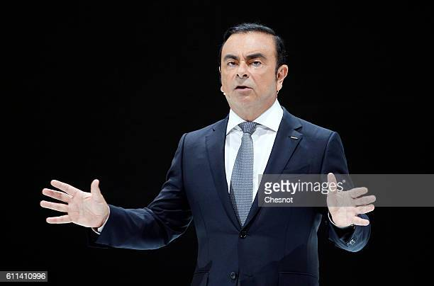 Carlos Ghosn chief executive officer of Renault SA and Nissan Motor Co speaks on stage as he presents the new Nissan Micra automobile during the...