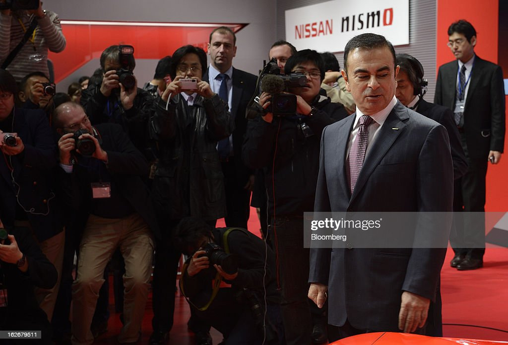 <a gi-track='captionPersonalityLinkClicked' href=/galleries/search?phrase=Carlos+Ghosn&family=editorial&specificpeople=215025 ng-click='$event.stopPropagation()'>Carlos Ghosn</a>, president and chief executive officer of Nissan Motor Co., poses during a photo session at the opening of the Nismo global headquarters and development center in Yokohama City, Japan, on Tuesday, Feb. 26, 2013. Ghosn, who has called 100 yen to the dollar the 'neutral' value for the Japanese currency, said the yen should weaken further. Photographer: Akio Kon/Bloomberg via Getty Images