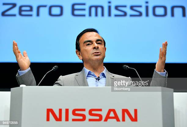 Carlos Ghosn president and chief executive officer of Nissan Motor Co speaks while introducing the 'Leaf' electric vehicle during the inauguration...