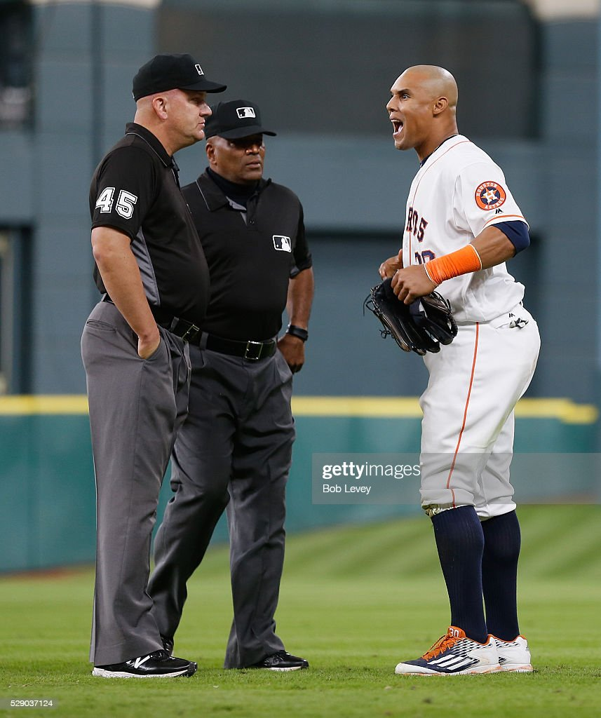 Carlos Gomez of the Houston Astros argues with crew chief Jeff Nelson and Laz Diaz as he took the field in the 10th inning on May 07 2016 in Houston...