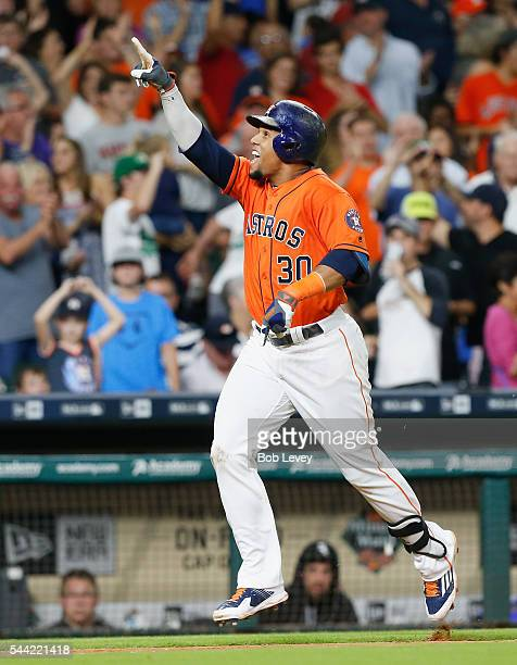 Carlos Gomez of the Houston Astros celebrates his tworun home run in the seventh inning against the Chicago White Sox at Minute Maid Park on July 1...