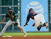 Carlos Gomez of the Houston Astros doubles in the eighth inning as Marcus Semien of the Oakland Athletics is late with the tag at Minute Maid Park on...
