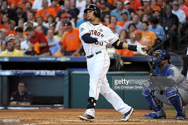 Carlos Gomez of the Houston Astros hits a solo home run in the second inning against the Kansas City Royals during game four of the American League...