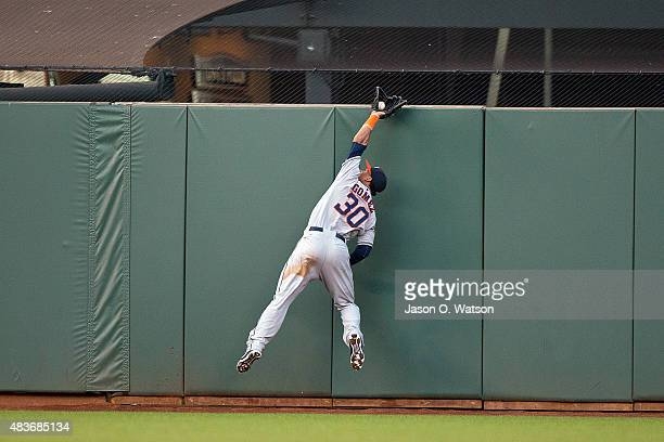 Carlos Gomez of the Houston Astros leaps for and catches a fly ball hit off the bat of Matt Duffy of the San Francisco Giants during the first inning...