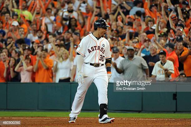 Carlos Gomez of the Houston Astros reacts after hitting an RBI single in the sixth inning against the Kansas City Royals in game three of the...