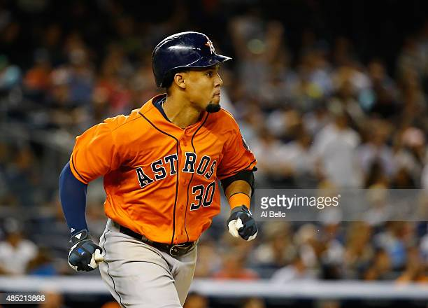 Carlos Gomez of the Houston Astros rounds the bases after hitting a three run home run against Chris Capuano of the New York Yankees in the seventh...
