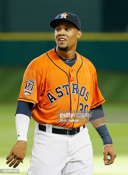 Carlos Gomez of the Houston Astros works out on the field before the start of their game against the Arizona Diamondbacks at Minute Maid Park on July...