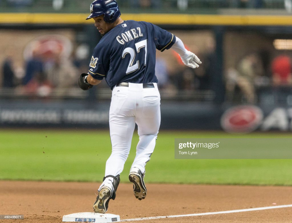 Carlos Gomez #27 of the Milwaukee Brewers beats out a bunt against the Arizona Diamondbacks at Miller Park on May 7, 2014 in Milwaukee, Wisconsin.