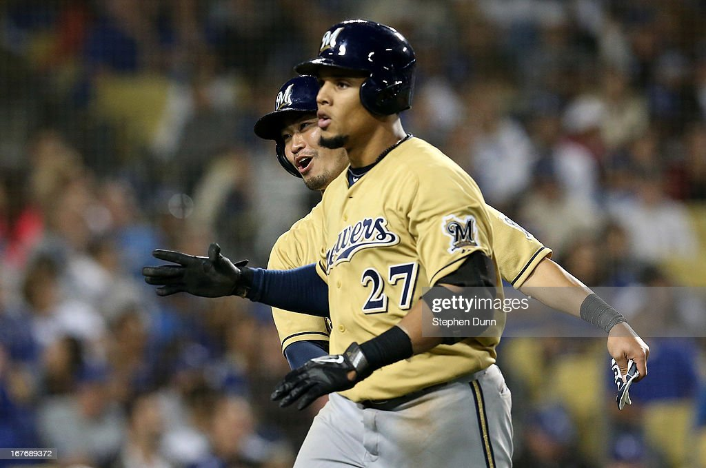 Carlos Gomez #27 of the Milwaukee Brewers celebrates with <a gi-track='captionPersonalityLinkClicked' href=/galleries/search?phrase=Norichika+Aoki&family=editorial&specificpeople=850957 ng-click='$event.stopPropagation()'>Norichika Aoki</a> #7 after both score on Gomez' two run home run in the seventh inning against the Los Angeles Dodgers at Dodger Stadium on April 27, 2013 in Los Angeles, California.