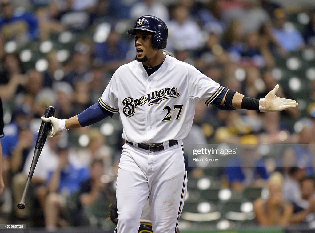 Carlos Gomez #27 of the Milwaukee Brewers complains about the umpire's ruling on a pitch during the ninth inning against the Pittsburgh Pirates at Miller Park on August 22, 2014 in Milwaukee, Wisconsin. The Pirates defeated the Brewers 8-3.