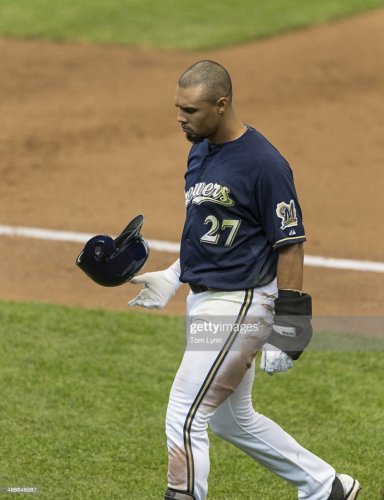Carlos Gomez #27 of the Milwaukee Brewers flips his helmet after hitting into a inning ending double play against the Arizona Diamondbacks at Miller Park on May 7, 2014 in Milwaukee, Wisconsin.