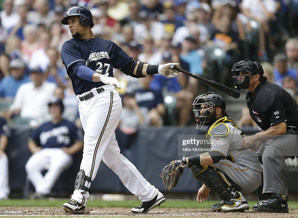 Carlos Gomez #27 of the Milwaukee Brewers hits a double in the bottom of the second inning against the Pittsburgh Pirates against the Milwaukee Brewers at Miller Park on August 24, 2014 in Milwaukee, Wisconsin.