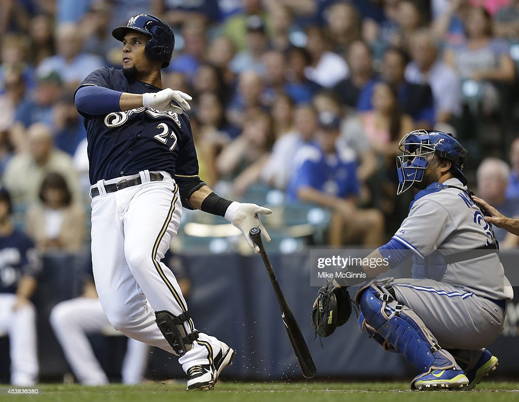 Carlos Gomez #27 of the Milwaukee Brewers hits a double in the top of the first inning against the Toronto Blue Jays during the Interleague game at Miller Park on August 19, 2014 in Milwaukee, Wisconsin.