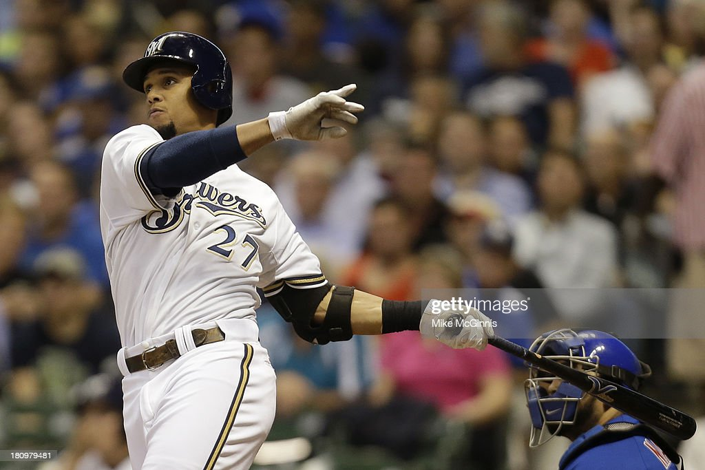 Carlos Gomez #27 of the Milwaukee Brewers hits a double scoring Norichika Aoki in the bottom of the fifth inning against the Chicago Cubs at Miller Park on September 18, 2013 in Milwaukee, Wisconsin.
