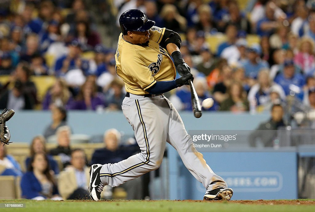 Carlos Gomez #27 of the Milwaukee Brewers hits a two run home run to give the Brewers the lead in the seventh inning against the Los Angeles Dodgers at Dodger Stadium on April 27, 2013 in Los Angeles, California.