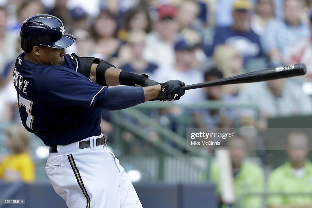 Carlos Gomez #27 of the Milwaukee Brewers hits a two run homer scoring Corey Hart in the bottom of the 3rd inning against the Pittsburgh Pirates at Miller Park on September 02, 2012 in Milwaukee, Wisconsin.