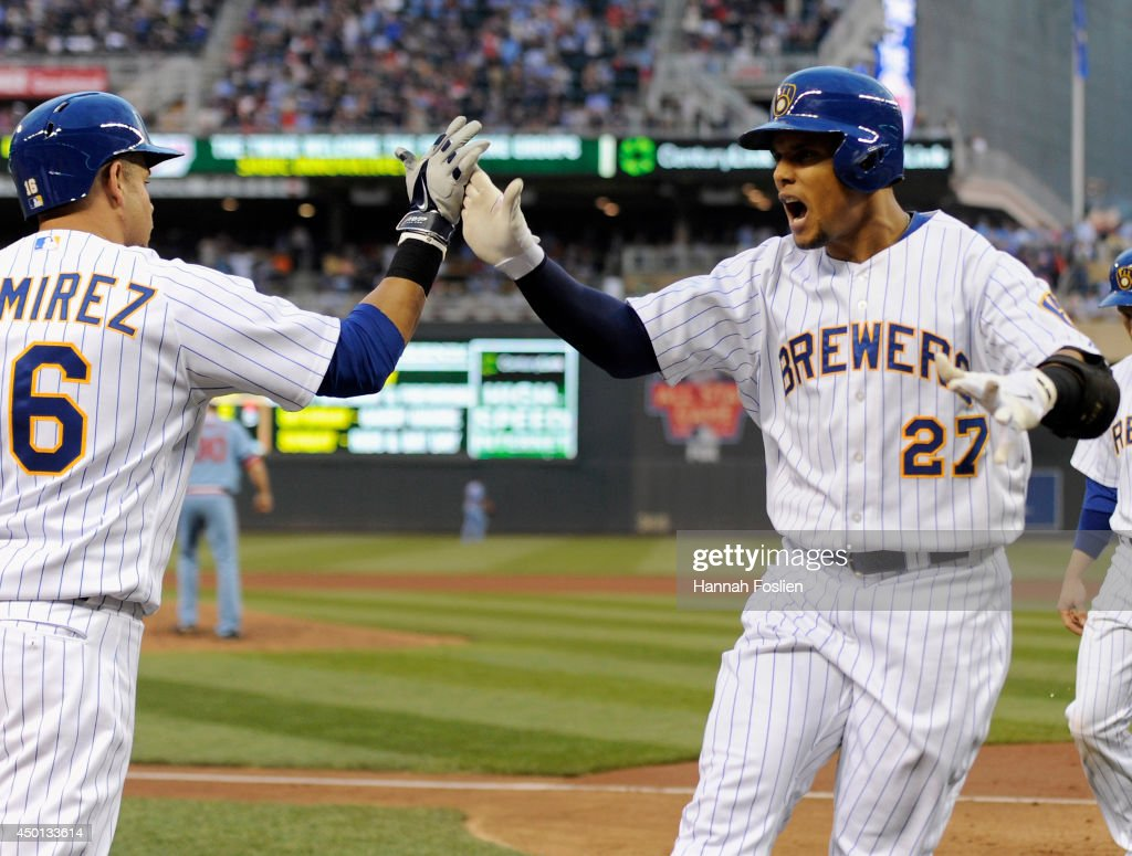 Carlos Gomez #27 of the Milwaukee Brewers is congratulated by Aramis Ramirez #16 on his three-run home run against the Minnesota Twins during the fourth inning of the game on June 5, 2014 at Target Field in Minneapolis, Minnesota.