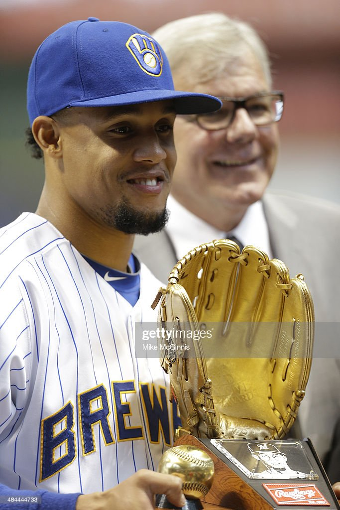 Carlos Gomez #27 of the Milwaukee Brewers is honored with a Golden Glove before the start of the game against the Pittsburgh Pirates at Miller Park on April 12, 2014 in Milwaukee, Wisconsin.