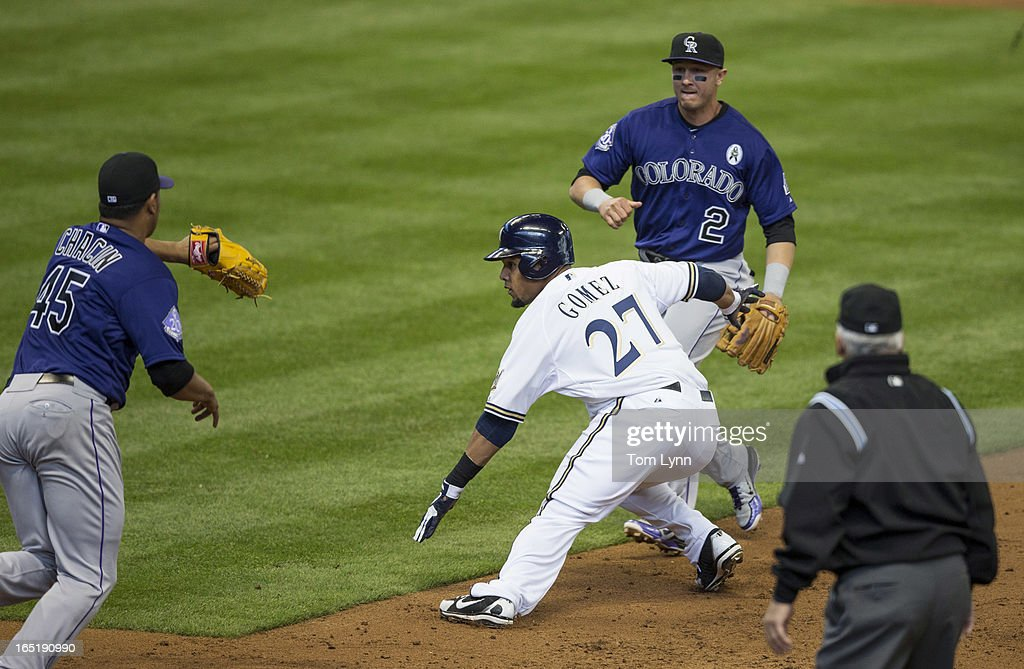 Carlos Gomez #27 of the Milwaukee Brewers is tagged out during a run down by <a gi-track='captionPersonalityLinkClicked' href=/galleries/search?phrase=Jhoulys+Chacin&family=editorial&specificpeople=5734320 ng-click='$event.stopPropagation()'>Jhoulys Chacin</a> $45 of the Colorado Rockies during the first inning on opening day at Miller Park on April 1, 2013 in Milwaukee, Wisconsin.