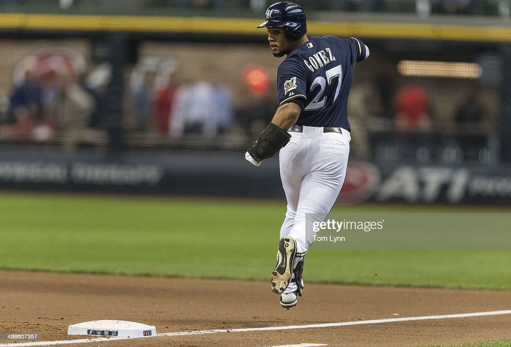 Carlos Gomez #27 of the Milwaukee Brewers looks back after beating out a bunt off of Bronson Arroyo #61 of the Arizona Diamondbacks at Miller Park on May 7, 2014 in Milwaukee, Wisconsin.