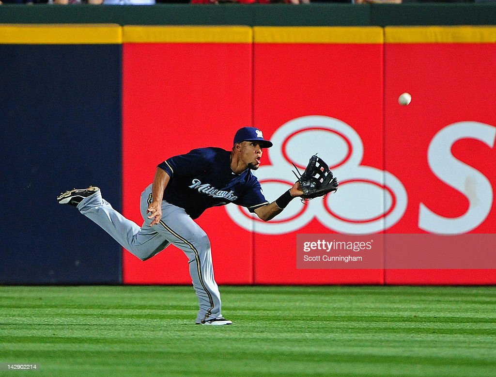 Carlos Gomez #27 of the Milwaukee Brewers makes a catch against the Atlanta Braves at Turner Field on April 14, 2012 in Atlanta, Georgia.