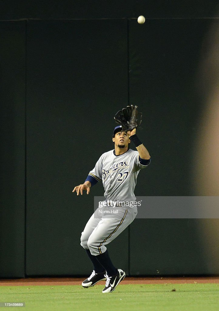 Carlos Gomez #27 of the Milwaukee Brewers makes a play on a fly ball against the Arizona Diamondbacks at Chase Field on July 14, 2013 in Phoenix, Arizona.