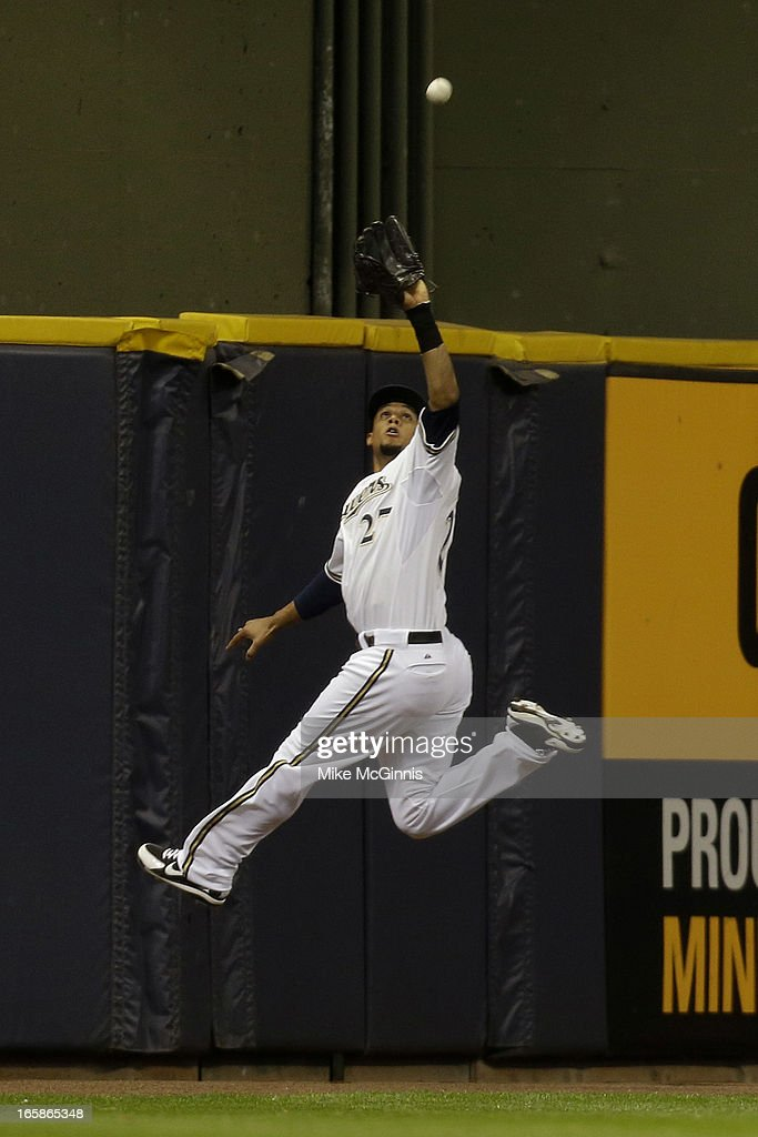 Carlos Gomez #27 of the Milwaukee Brewers makes an outstanding jumping catch in center field to retire Gerardo Parra of the Arizona Diamondbacks in the top of the first inning at Miller Park on April 6, 2013 in Milwaukee, Wisconsin.