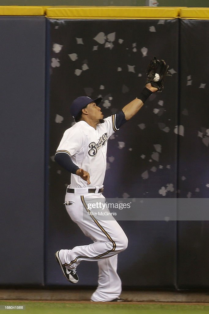 Carlos Gomez #27 of the Milwaukee Brewers makes the catch at the wall to retire Matt Holliday of the St. Louis Cardinals during the top of the sixth inning at Miller Park on May 04, 2013 in Milwaukee, Wisconsin.