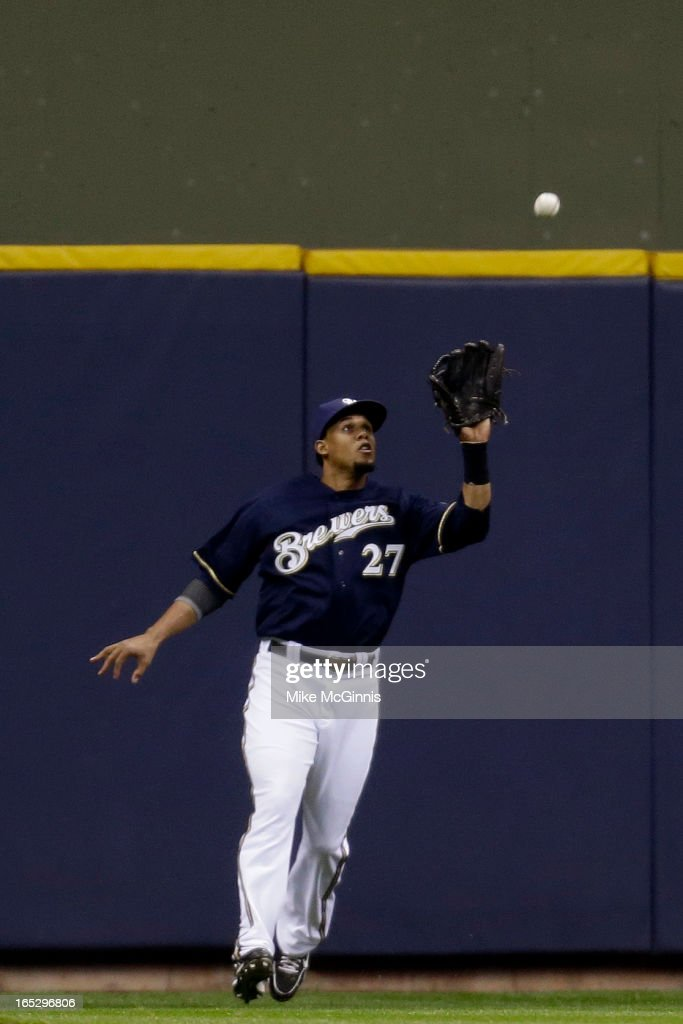 Carlos Gomez #27 of the Milwaukee Brewers makes the catch in center field to retire Carlos Gonzalez of the Colorado Rockies during the top of the first inning at Miller Park on April 2, 2013 in Milwaukee, Wisconsin.