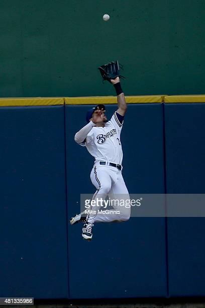 Carlos Gomez of the Milwaukee Brewers misses this leaping catch at the wall in centerfield allowing Jaff Decker of the Pittsburgh Pirates a triple...