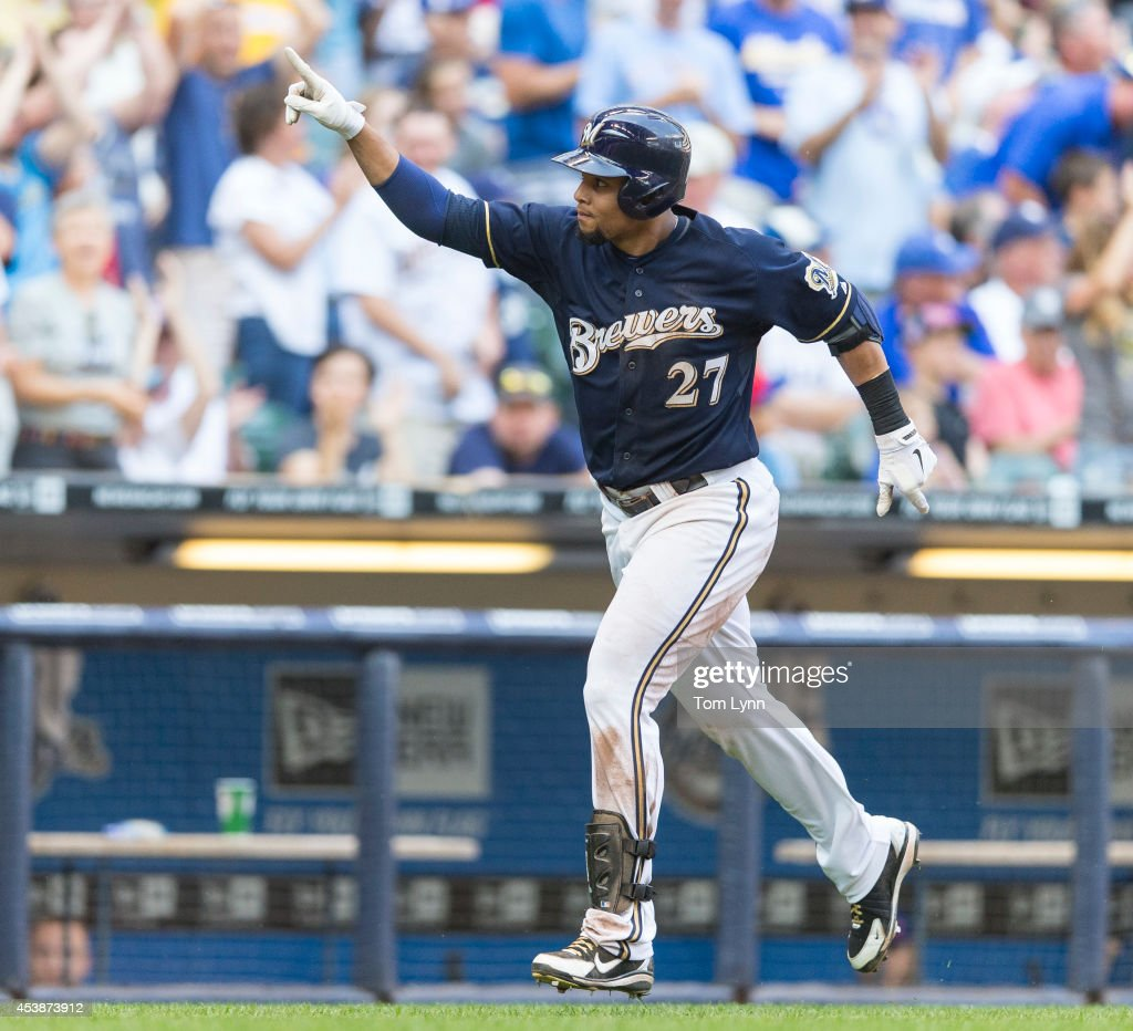 Carlos Gomez #27 of the Milwaukee Brewers points to the stands after hitting a two run home run against the Toronto Blue Jays at Miller Park on August 20, 2014 in Milwaukee, Wisconsin.
