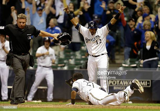 Carlos Gomez of the Milwaukee Brewers reaches home on a hit by Yuniesky Betancourt in the bottom of the tenth inning putting the Brewers on top 43...