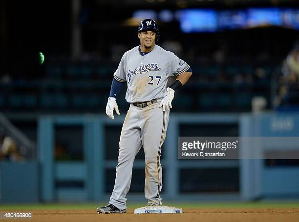 Carlos Gomez of the Milwaukee Brewers reacts standing on second base after hitting a tworun double against the Los Angeles Dodgers during the seventh...