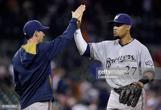 Carlos Gomez of the Milwaukee Brewers receives a highfive from manager Craig Counsell of the Milwaukee Brewers after a 32 win over the Detroit Tigers...